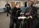 Cardinal Francis Arinze, right, one of Rome's top cardinals and one of those frequently mentioned...