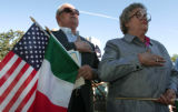 Luigi Caprano (cq) 75, and his wife Olga (cq) 72, holding the U.S and Italian Flag, originally...