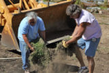 Gerg Tonozzi (cq) of Marble, Colorado gets help from Lou Gonzalez (cq) of Bailey placing sod near...