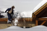 (EVERGREEN, Colo., April11, 2005)  Jack Jordan (cq), of Jordan Roofing, removes snow from a roof...
