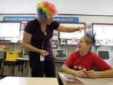 Kari Vier (cq) checks out her student Virginia Nystrom's (cq) hairdo on Crazy Hair Day Thursday,...