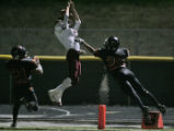 Faith Christian wide receiver Micah Tweddell, middle, can't make the catch being defended by...