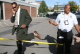 PIO's Detective John White, left with knee coming over the tape and Sonny Jackson get information...