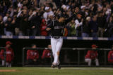 [ES0475] Yorvit Torrealba cheers on Kazuo Matsui as Matsui goes to third on his triple in the...