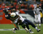 Ian Gold Tackle LaDainian Tomlinson in the third quarter of the Denver Broncos against the San...