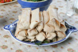 "A plate of fake blintzes on the dinner table:  props from the play, ""You Can't Take it With..."