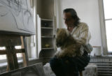 (Denver, Co} shot on 4/11/05})  Josh Armijo (cq)  holds his dog Mr Blue before his art class at...