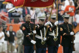 0390 The hat of a Marine honor guard member gets caught on the U.S. Marines flag and is whipped...