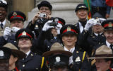 Making memories Canadian police officers take pictures of the scene at the City and County...