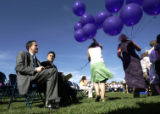 0388 Injured student Patrick Ireland, left, sits next to Columbine High School principal Frank...