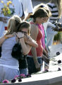 0335 Young Women hug inside the memorial during the Columbine Memorial dedication ceremony at the...