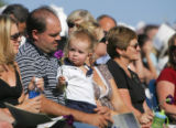 People at the dedication ceremony for the Columbine Memorial at Clement Park in Littleton, Colo.,...