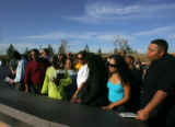 Michael and Vonda Shoels (left) and family members look at the Columbine Memorial at Clement Park...