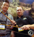 Bass Pro Shops reps Scott Shotts, left, and Andy Whaley, of Springfield Mo., examine fly rods Sage...