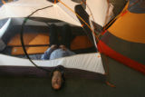 Dr. Steven J. Schwartz mostly inside an REI Half Dome 2 person backpack tent at REI: Denver, Colo....