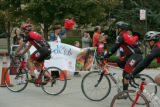 The cyclists head into the finish - the front entrance of The Children's Hospital Monday afternoon...