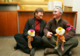 Partners Kate Burns (cq), left, and Sheila Schroeder (cq), right, both of Englewood, hold flowers...