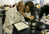 Dolores Clark, right, comforts her son, Akio Clark, 29, left, who is emotional after receiving a...