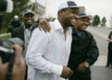 Denver Bronco's NFL 4th draft pick Maurice Clarett, center, running back from Ohio State,  is...