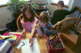 (COLORADO SPRINGS, Colo., April 14, 2005) Payton Keller (cq), left, 7, writes a letter to her...