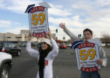 Erika Jensen(cq),left, and friend Travis Gasper hold signs showing their view on amendment 59, at ...