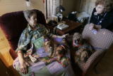 88 year old  Aleon DeVore, left, visits with Gail Mespley and her therepy dogs  at the Hospice of...