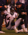 (CS856) Ryan Torain is helped up after getting hurt in the second quarter of the Denver Broncos...