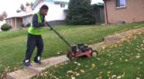 Jose Baeza, 18, mows the lawn for Augustine Narcisse at her home in Denver on Tuesday, October 21,...