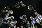 DM2916  The Valor Christian High School Eagles bow their heads in prayer before facing the...