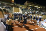 DM2876  The Valor Christian fans take to their feet as junior Sam Grizzle leads his team out of...