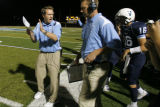 DM3016  Valor Christian head coach Brent Vieselmeyer encourages his players as the offense takes...