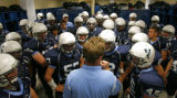 DM3040  Valor Christian head coach Brent Vieselmeyer talks to his players at the half while...