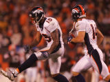 (CS1385) Brandon Marshall celebrates his game-winning touchdpwn in the fourth quarter of the...