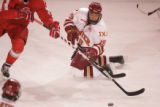 #19 Kyle Ostrow (cq) of Denver reaches for the puck as the Denver Pioneers take on the Ohio State...