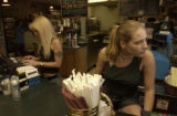 Mary Carbone(cq)(LEFT, long blonde hair working cash register, large tatoo on left upper arm)...