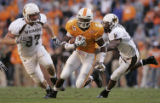 TNWP116 - Tennessee's Denarius Moore (6) outruns Wyoming's Alex Stover (97) and Quincy Rogers...