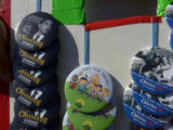 Buttons selling outside the Barack Obama rally include depictions of him with former President...