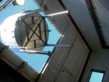 Workers use a crane to lower a new lauter tun through the roof of Left Hand Brewing in Longmont....