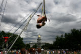 (PG12625) Angela Roy, 27, of Denver, does a flip on the bungy jump while spending time at the...