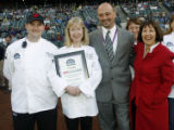 Rocky Mountain News food editor Marty Meitus, right, and cookoff winners Matthew Danley, left,...