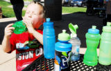 Sean Bopp, 4, of Arvada takes a giant swig from his bottle during a water break from playing on...