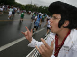 DM1832  Dressed as Elvis, Peter Szameitat, 27, encourages runners in the Boulder Bolder as the...
