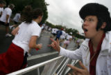 DM1833  Dressed as Elvis, Peter Szameitat, 27, encourages runners in the Boulder Bolder as the...