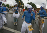 DM1858  Dressed as Smurfs Brent Abbott and his friends dance their way up Folsom Street during the...