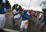 DM1870  Dressed as Smurfs Brent Abbott and his friends dance their way up Folsom Street during the...