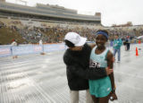 DM2665  Kenya's Millicent Gathoni gets a hug from Carolyn Mather of Morganton, Ga. after crossing...