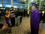 After South HS graduation, Ricardo Escobedo has his picture taken by his cousin Saida Escobedo as...