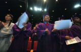 At South HS graduation, Ricardo Escobedo shows his excitement as the ceremony begins at the...