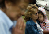 (at right) 3 year-old Ajalil Kawamura (cq) is embraced by her grandmother, Gail Kawamura (cq)...