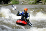 Chris Popovich (cq), 31, of Louisville paddles over one of a number of small waterfalls on Boulder...